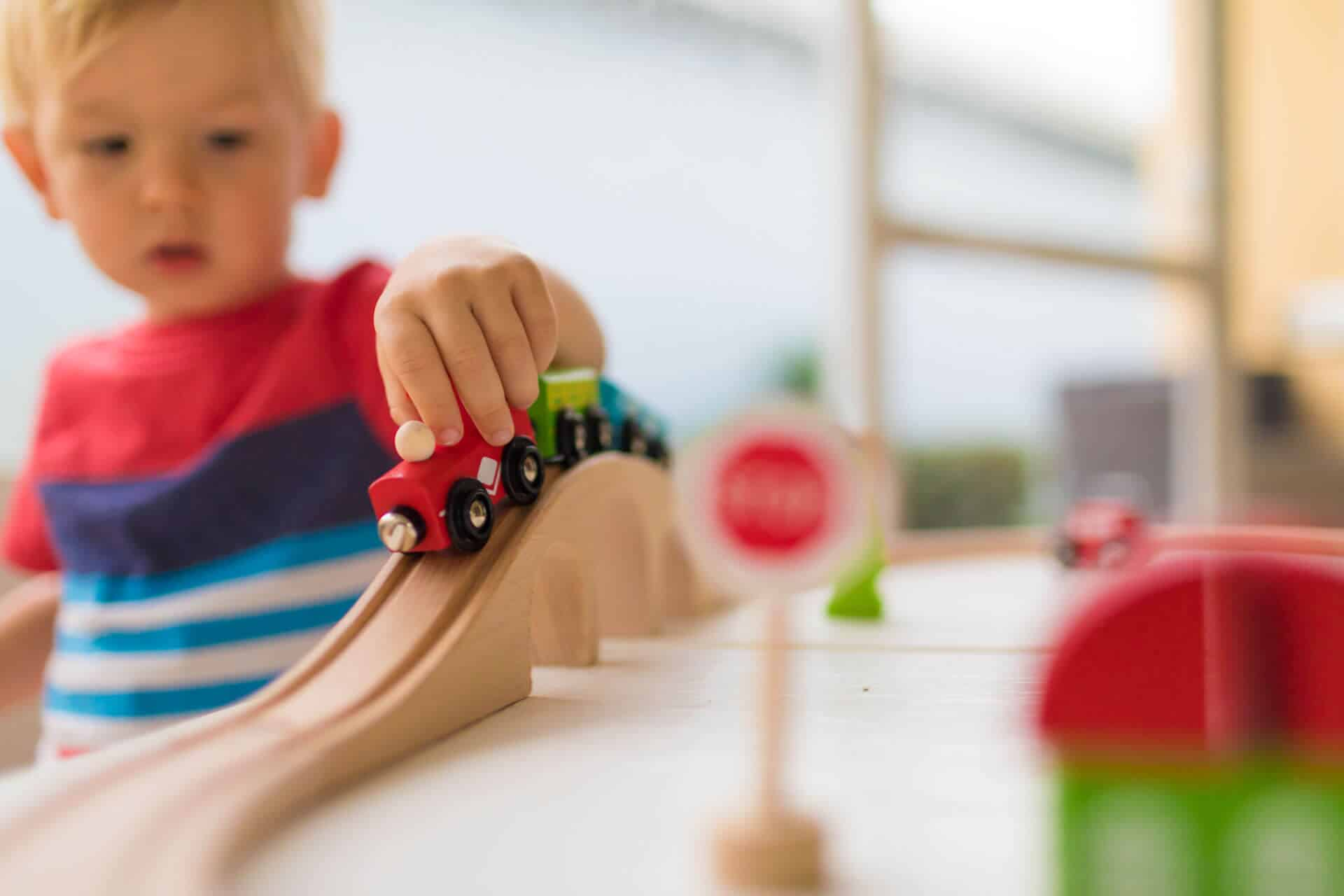preschooler playing with train